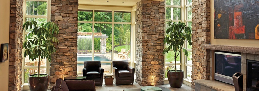 08-living-room-stone-wall.jpg